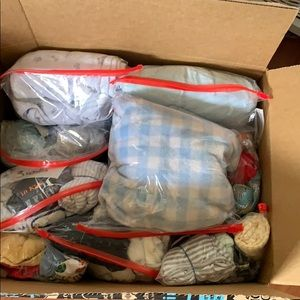 Box of clothes for T Shirley